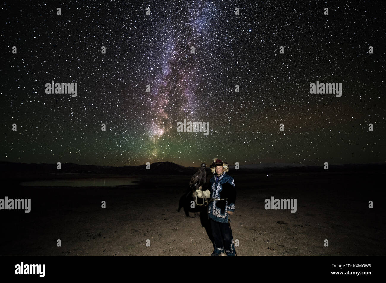 Milky way nightsky astrophotography nightscape stars golden eagle hunter Mongolia kazakh - Stock Image