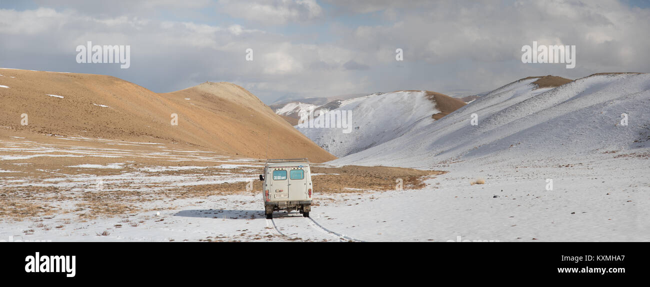 Russian UAZ 452 van camper desert snow in Mongolia - Stock Image