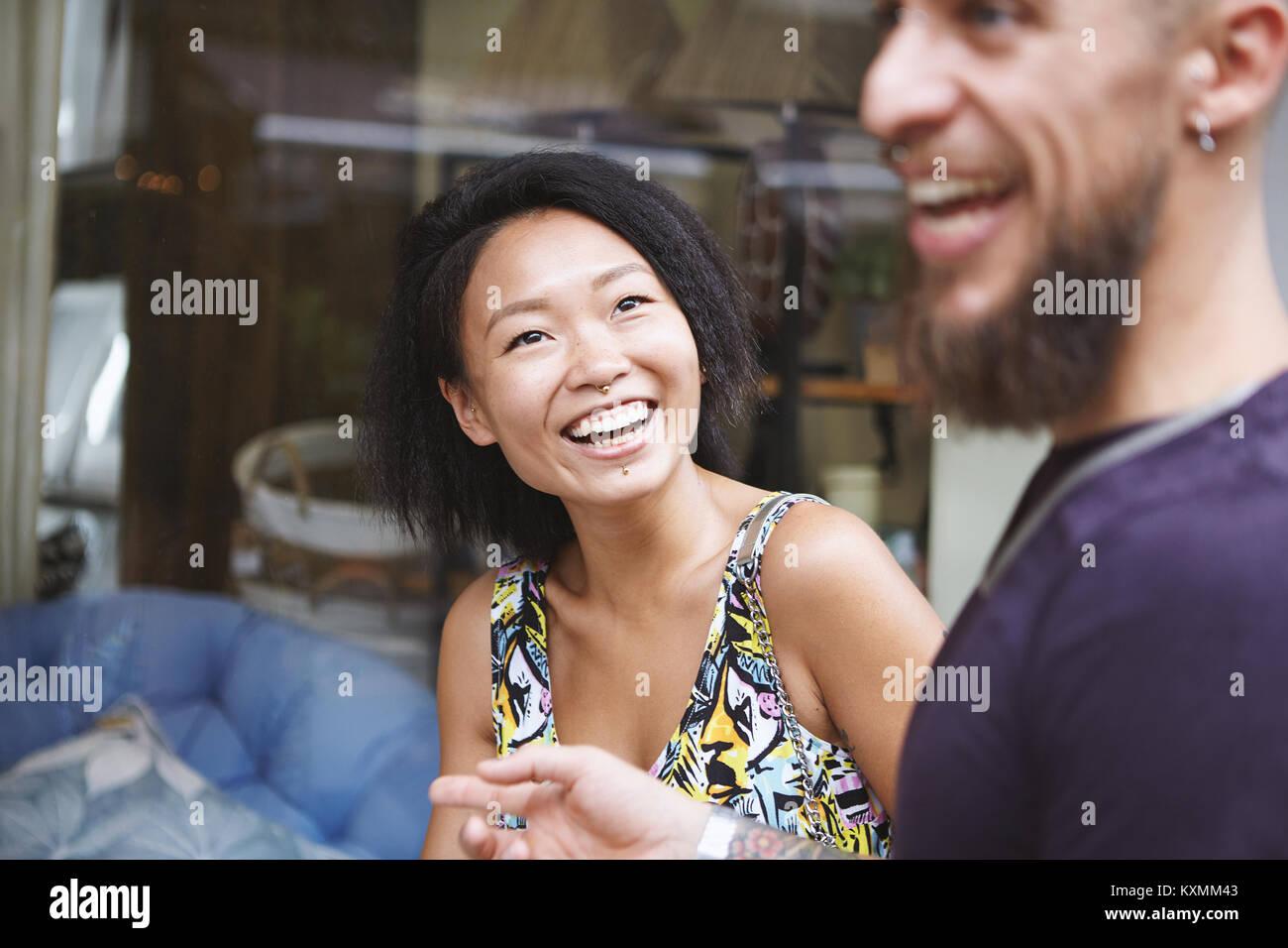 Multi ethnic hipster couple window shopping,Shanghai French Concession,Shanghai,China - Stock Image