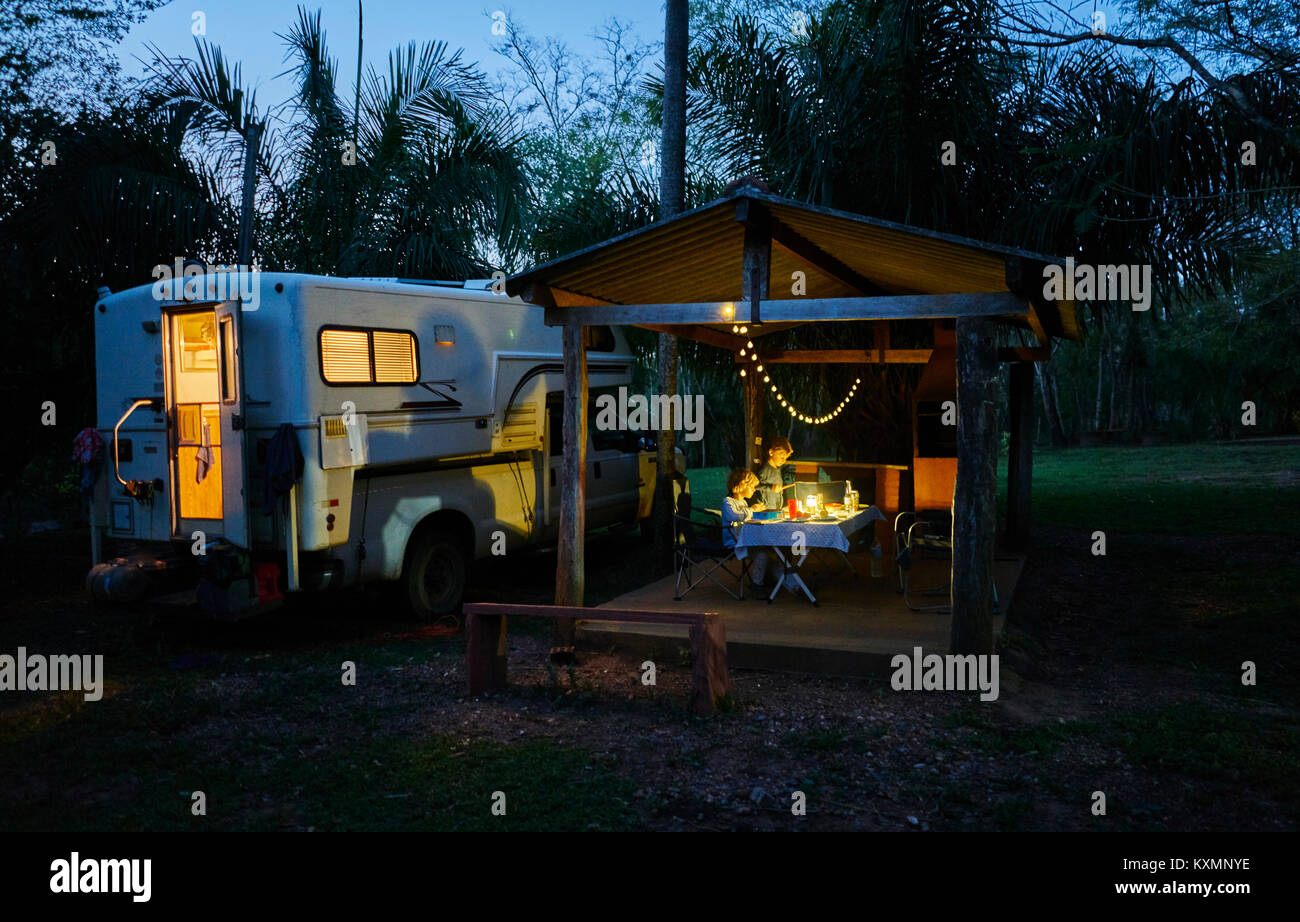 Campervan parked on campsite by picnic shelter at night,Bonito,Mato Grosso do Sul,Brazil,South America - Stock Image