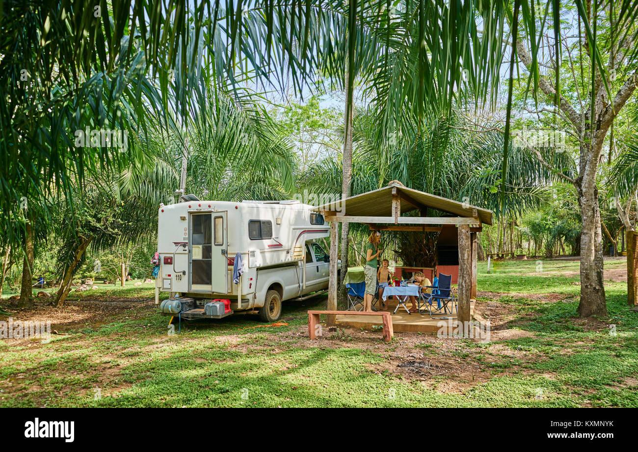Campervan parked on campsite by picnic shelter,Bonito,Mato Grosso do Sul,Brazil,South America - Stock Image