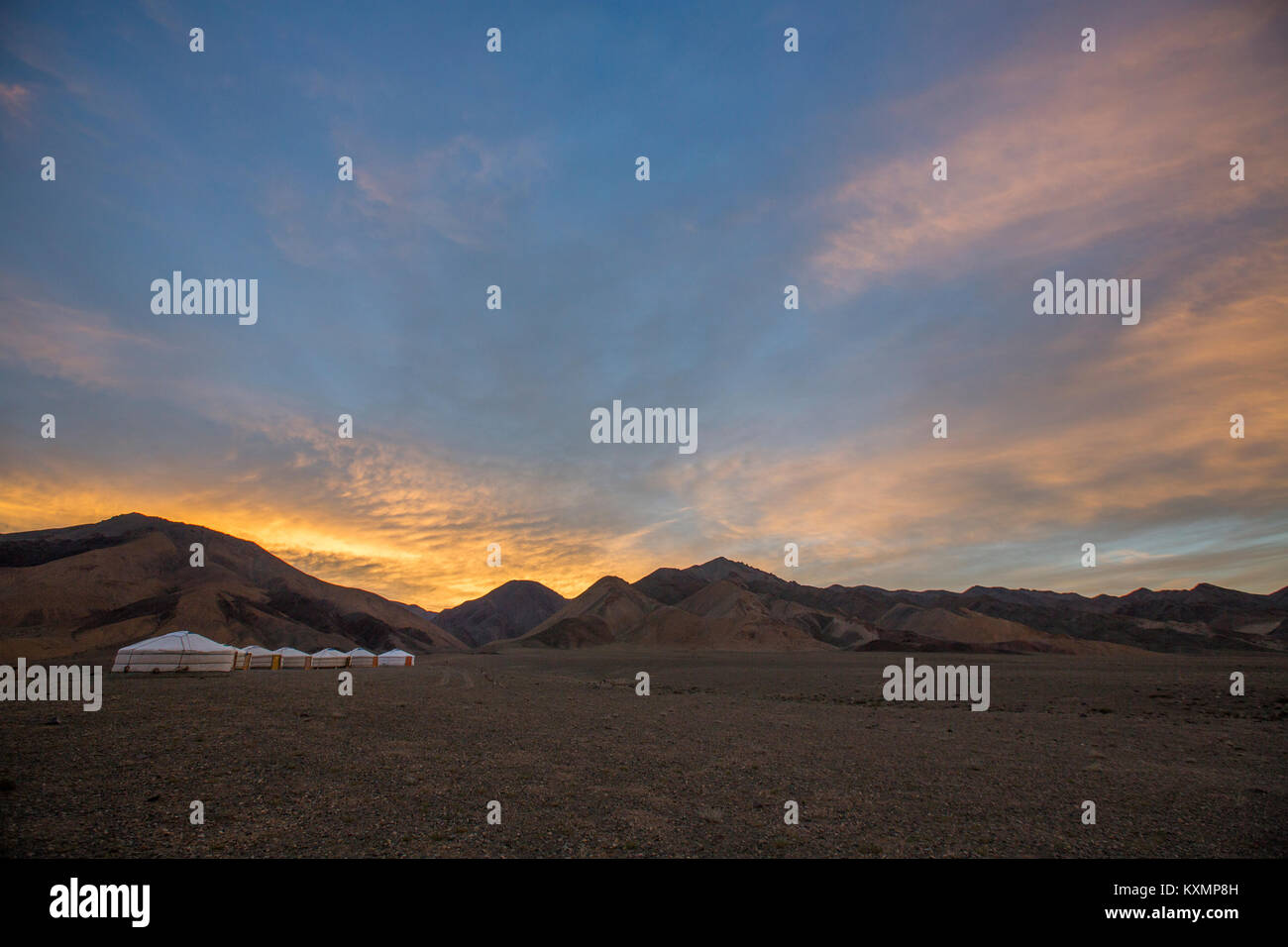 Scenic view with row of yurts in Altai Mountains at sunrise,Khovd,Mongolia - Stock Image