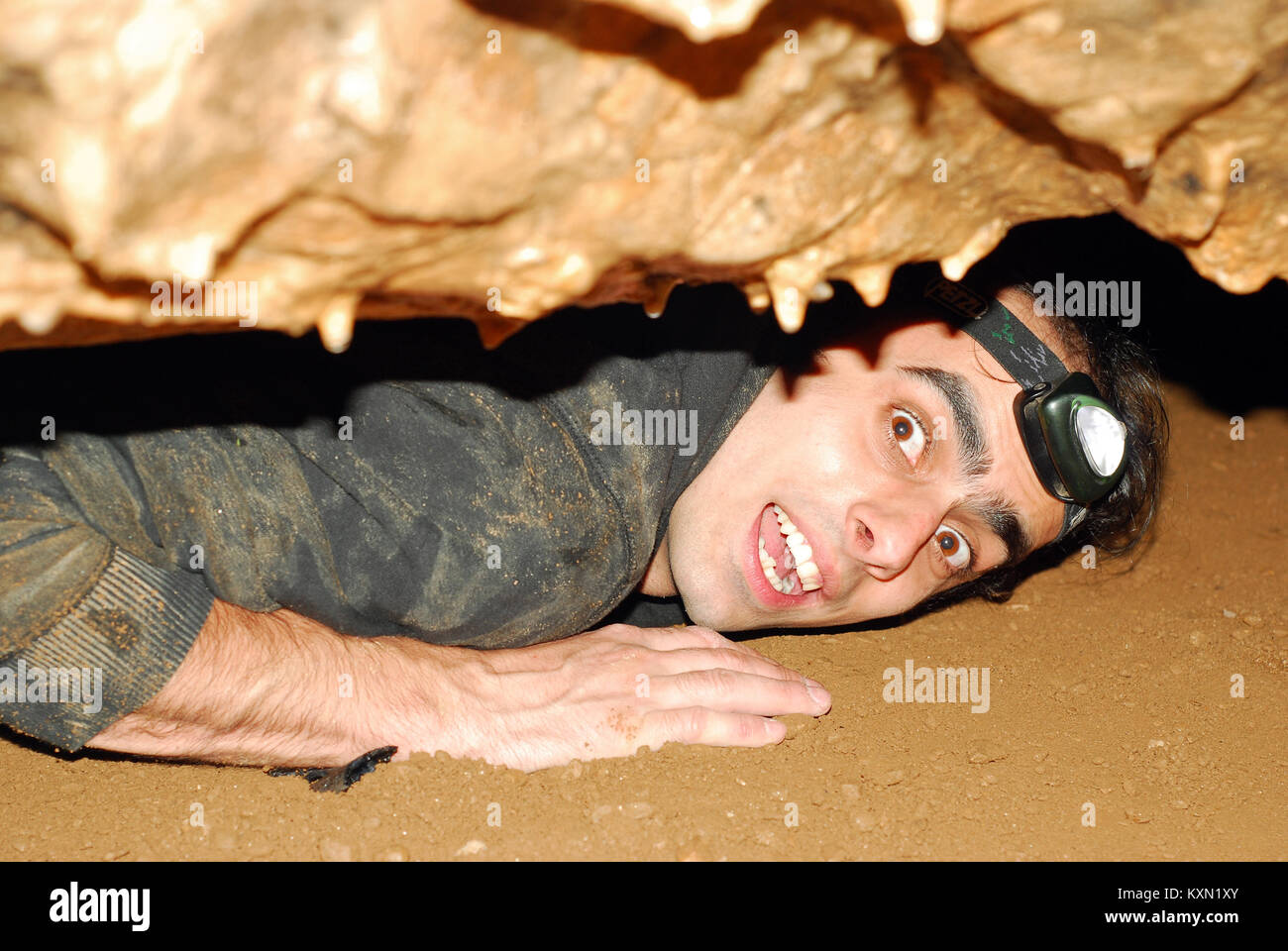 cave explorer in a tight spot - Stock Image