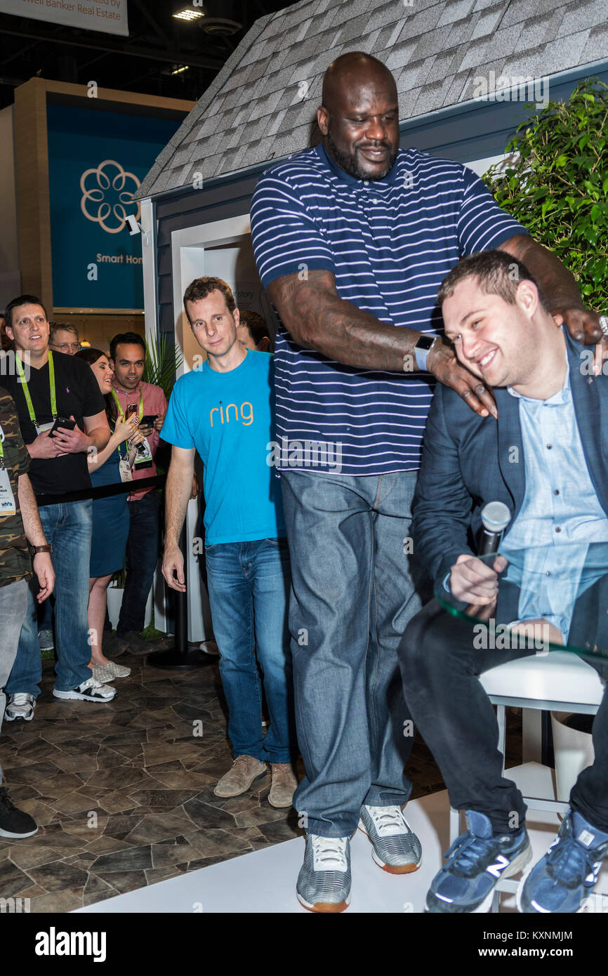 Las Vegas, NV, USA. 10th Jan, 2018. Ring CEO James Siminoff watches from behind as Shaquille O'Neal massages - Stock Image
