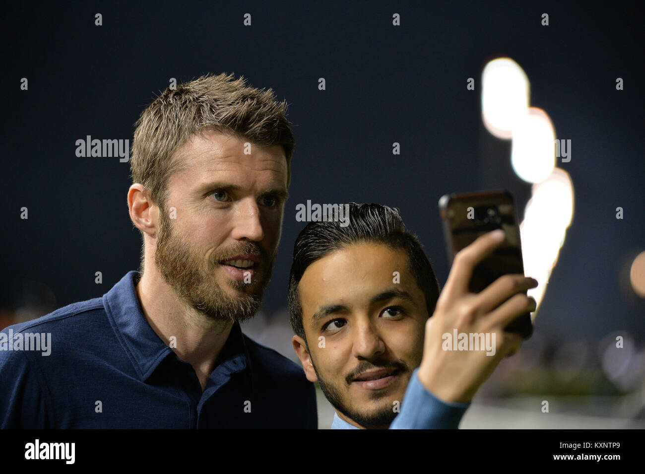 Dubai, UAE. 11th January 2018. Michael Carrick, captain of the Manchester United football club, interacts with a - Stock Image
