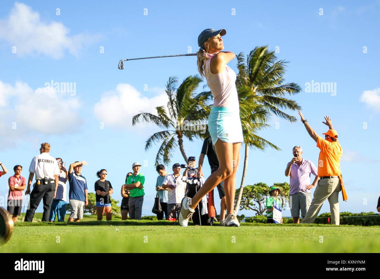 Honolulu, Hawaii, USA. Honolulu, Hawaii, USA. 10th Jan, 2018. Kelly Rohrbach watches her ball off the 17th tee box - Stock Image