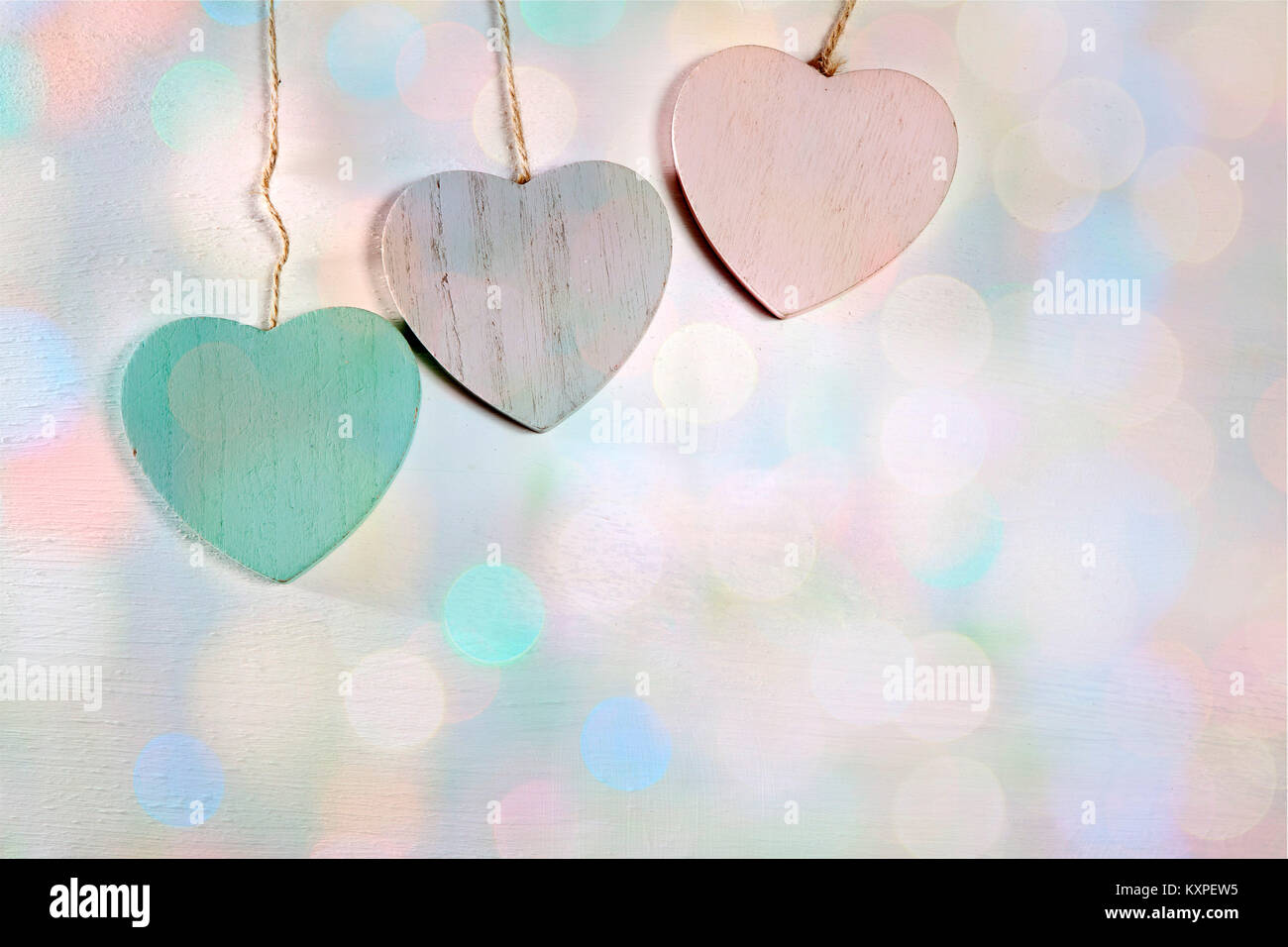 The Three Wooden Hearts Hang On A Wooden Wall Stock Photo 171368993