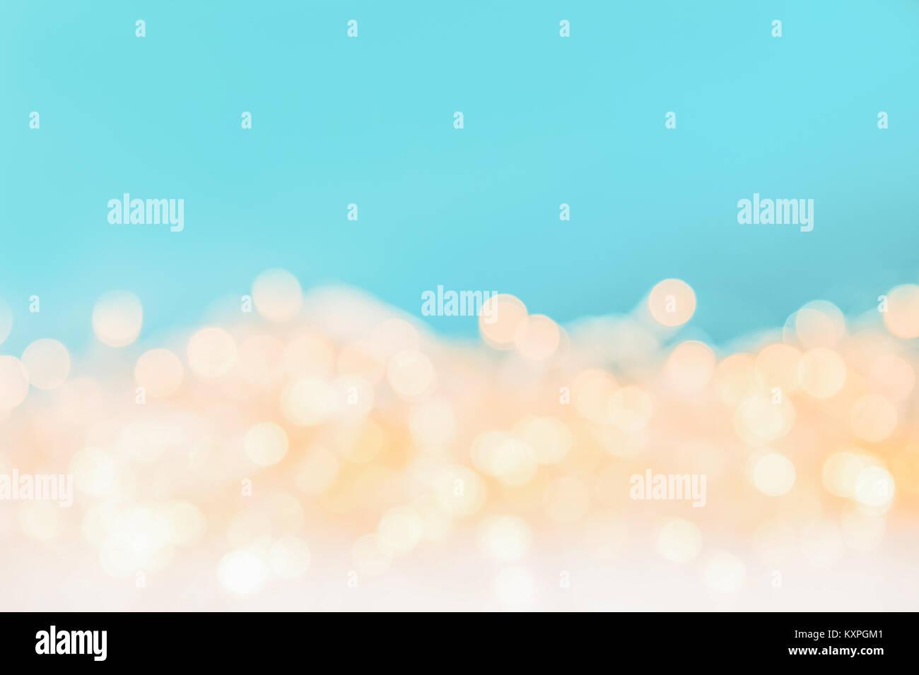 shiny christmas bokeh lights on blue background - Stock Image