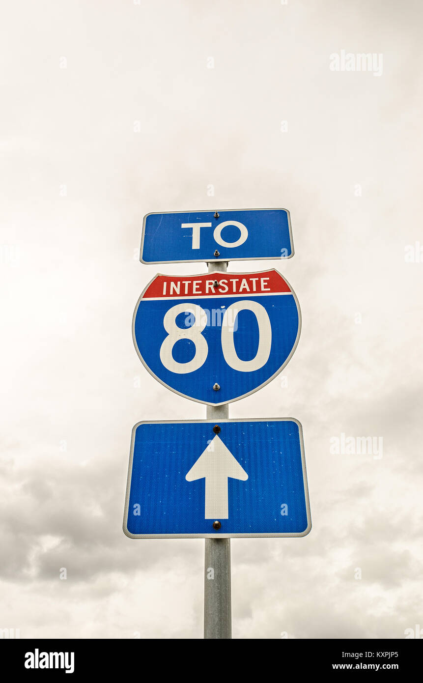 Three signs to let motorists know that they are going the right way if they want to get to Interstate 80 - Stock Image