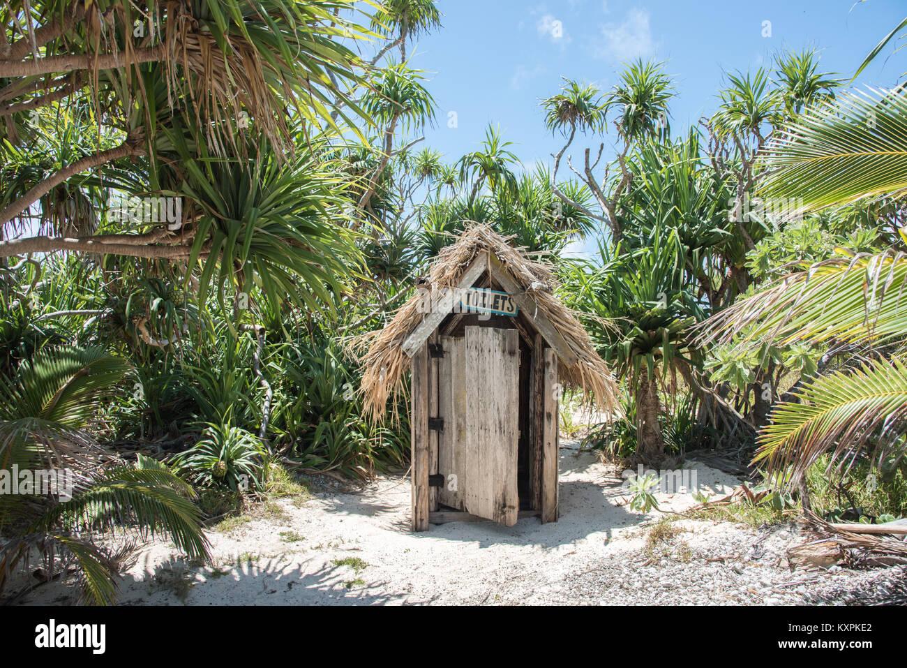 Rustic toilet in the remote tropical rainforest on the uninhabited Mystery Island, Vanuatu - Stock Image