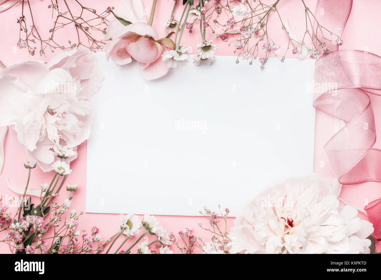 White blank card with pastel flowers and ribbon on pink pale stock white blank card with pastel flowers and ribbon on pink pale background floral frame creative greeting invitation and holiday concept mightylinksfo