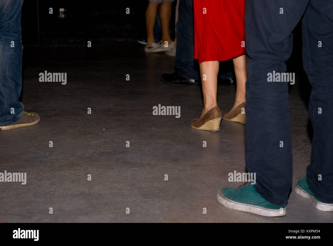 cropped view of several dancer's legs dancing in a nightclub in Marseille, FRANCE - Stock Image