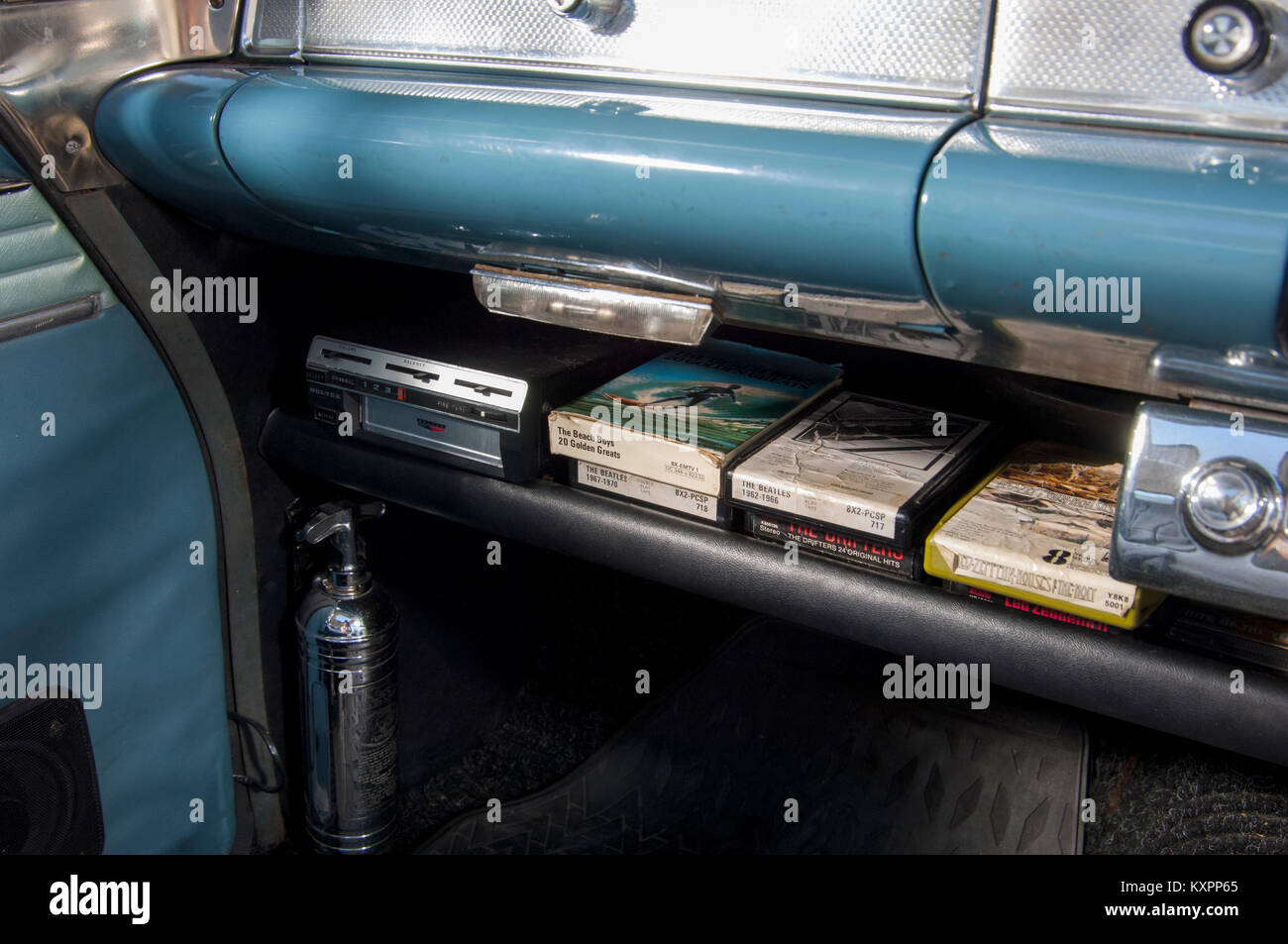 Eight Track tapes in a classic car dashboard Stock Photo