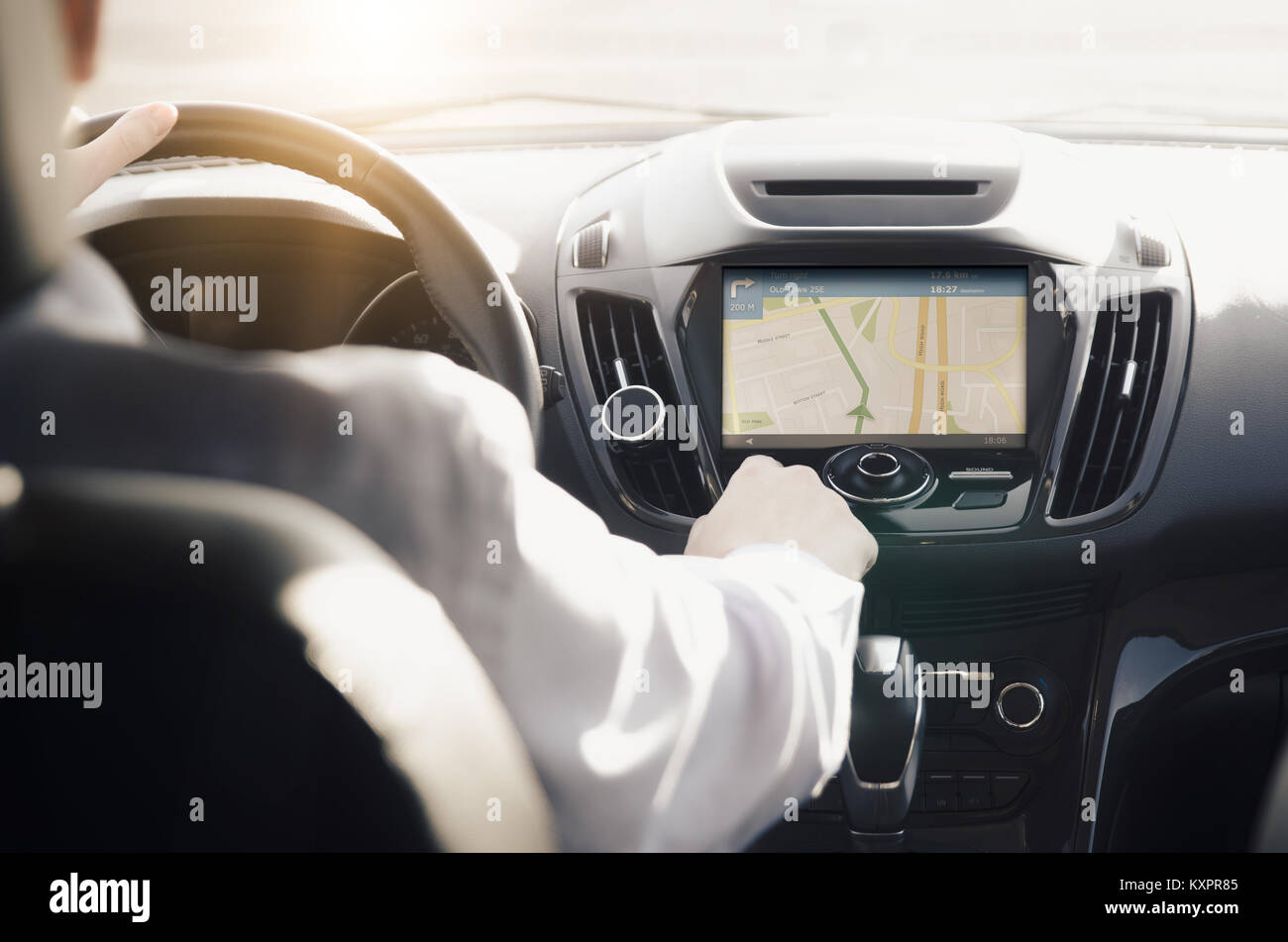 GPS navigation system. Person driving a car with satellite navigation. - Stock Image