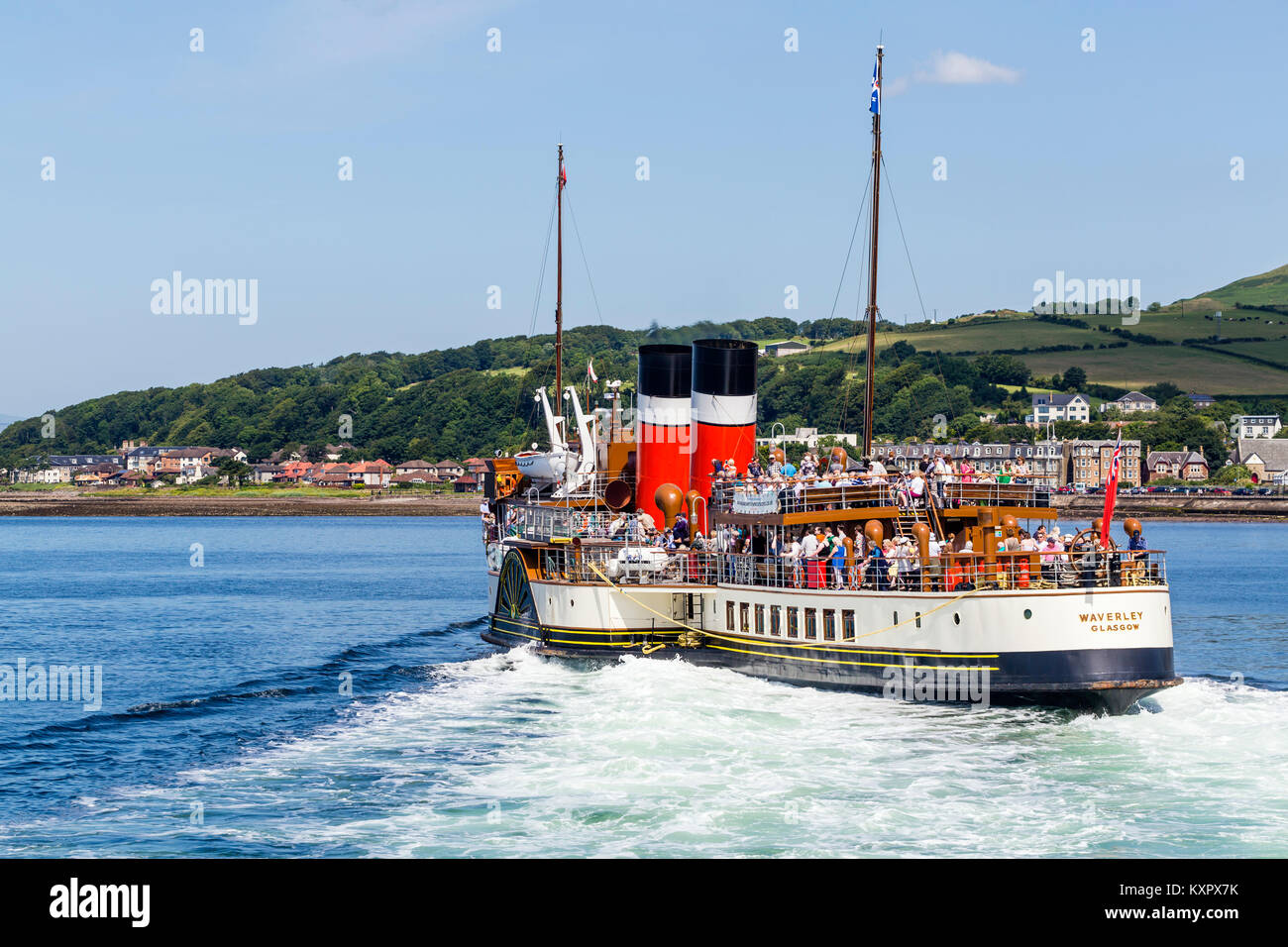 The Waverley Paddle Steamer departing from the town of Largs on the Firth of Clyde, North Ayrshire, Scotland UK - Stock Image