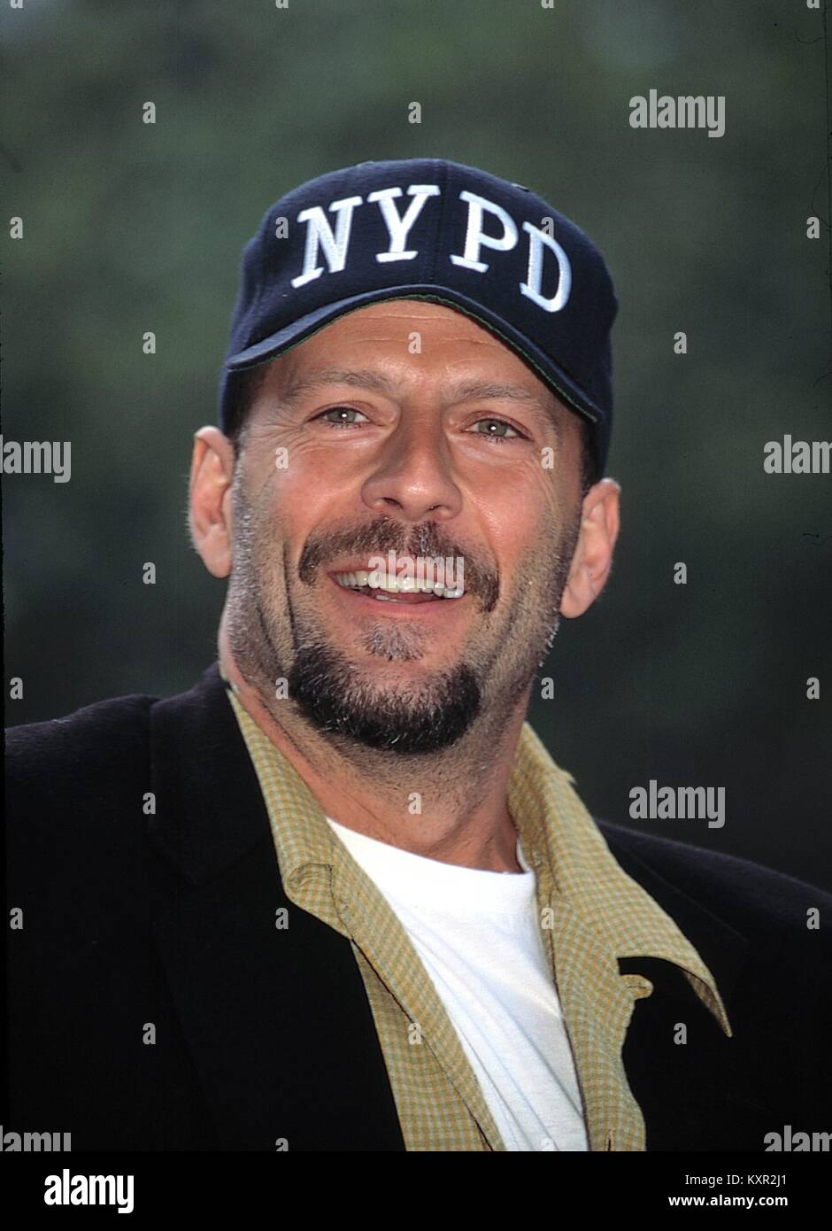 Bruce Willis Attending the Crystal Apple Awards at Gracie Mansion in New York City. June 14, 1995 © RTMcbride / Stock Photo