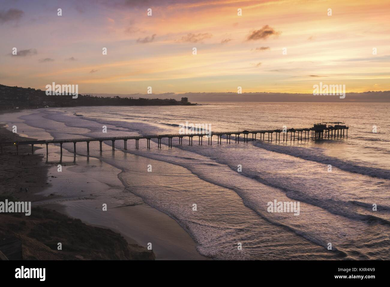 Dramatic Sunset Sky, Scripps Pier Institute of Oceanography and La Jolla Shores Beach below UCSD north of San Diego - Stock Image