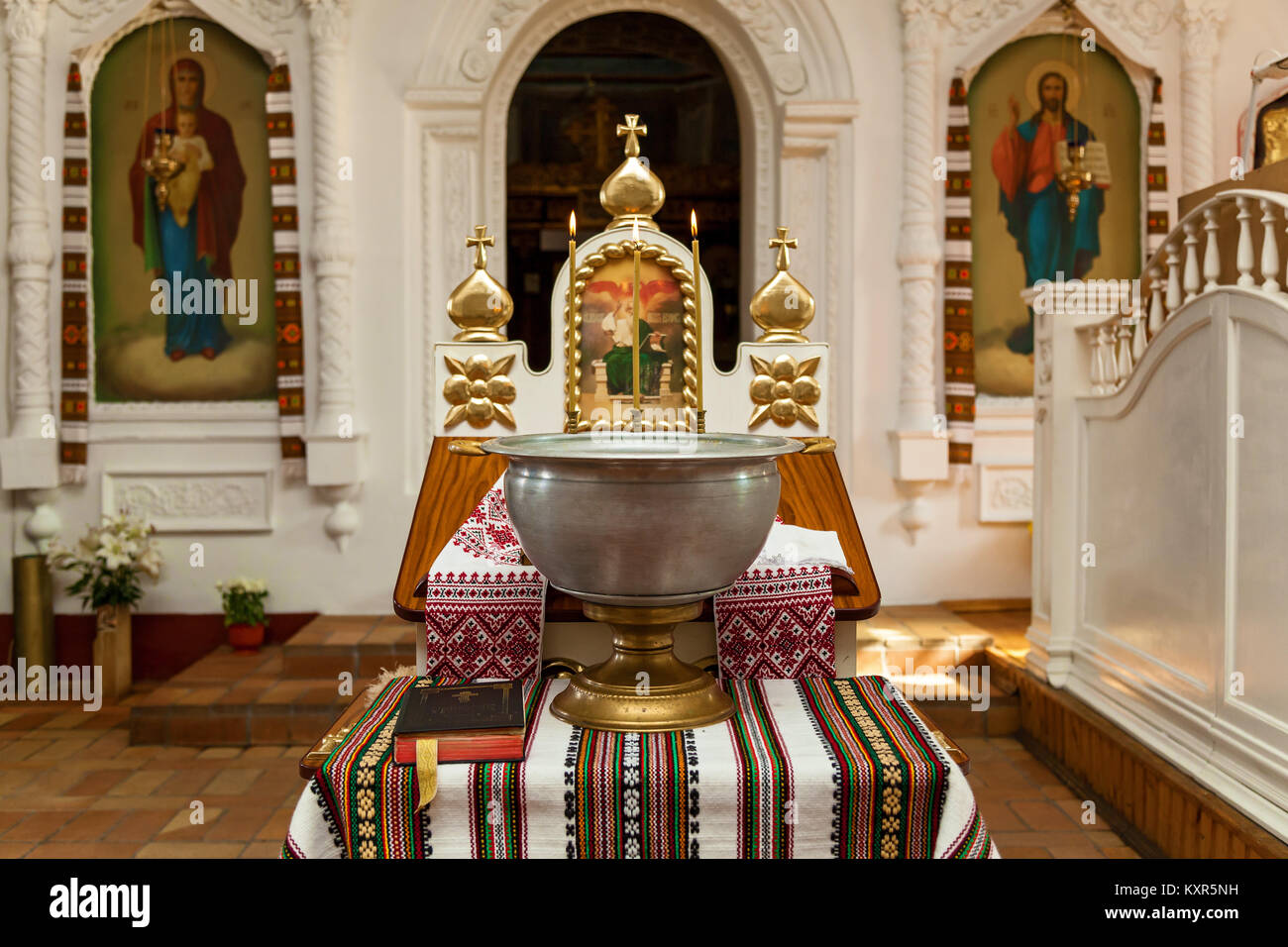 Accessories for the christening of children icons of candles and font, Orthodox Church. The Sacrament of Children's - Stock Image