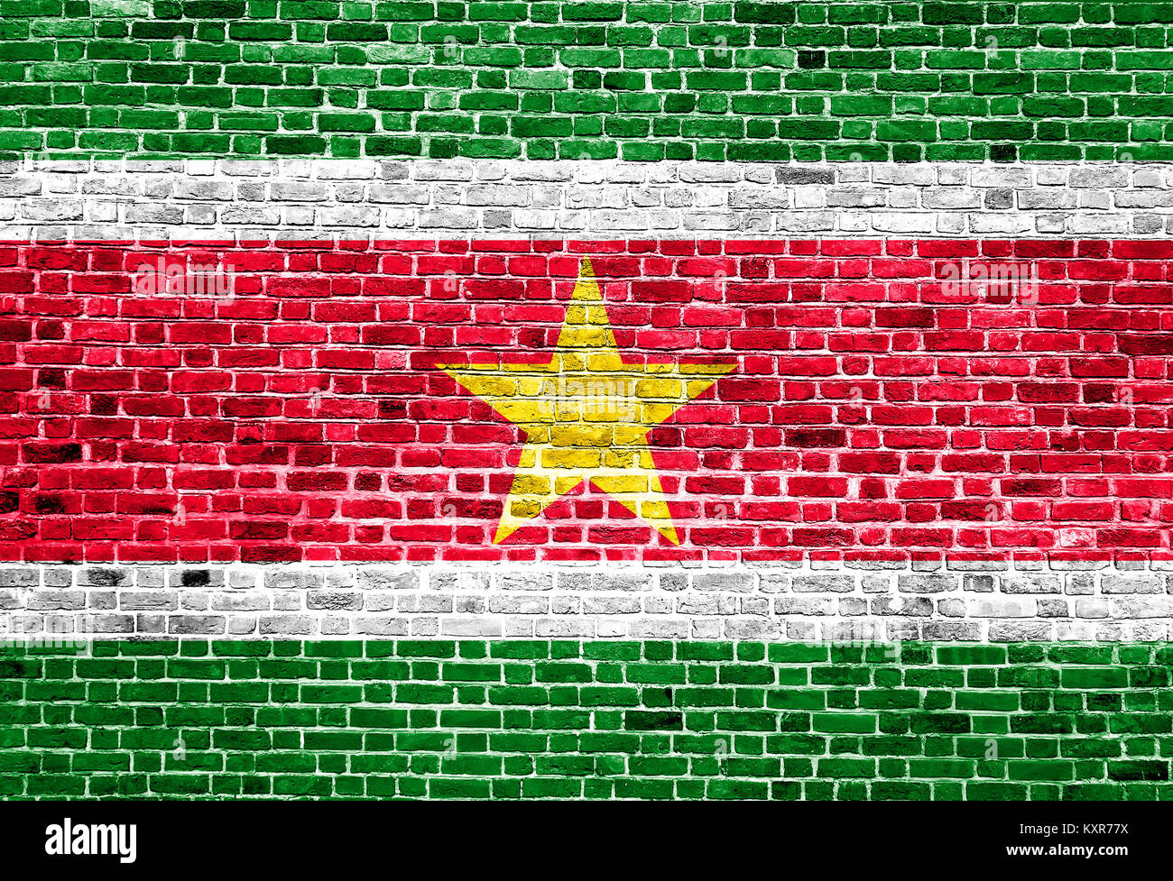 Flag of Suriname painted on brick wall - Stock Image