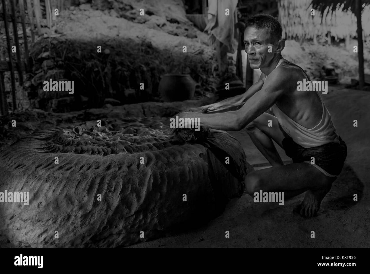 Men making pot from clay in Yangon, Myanmar - Stock Image