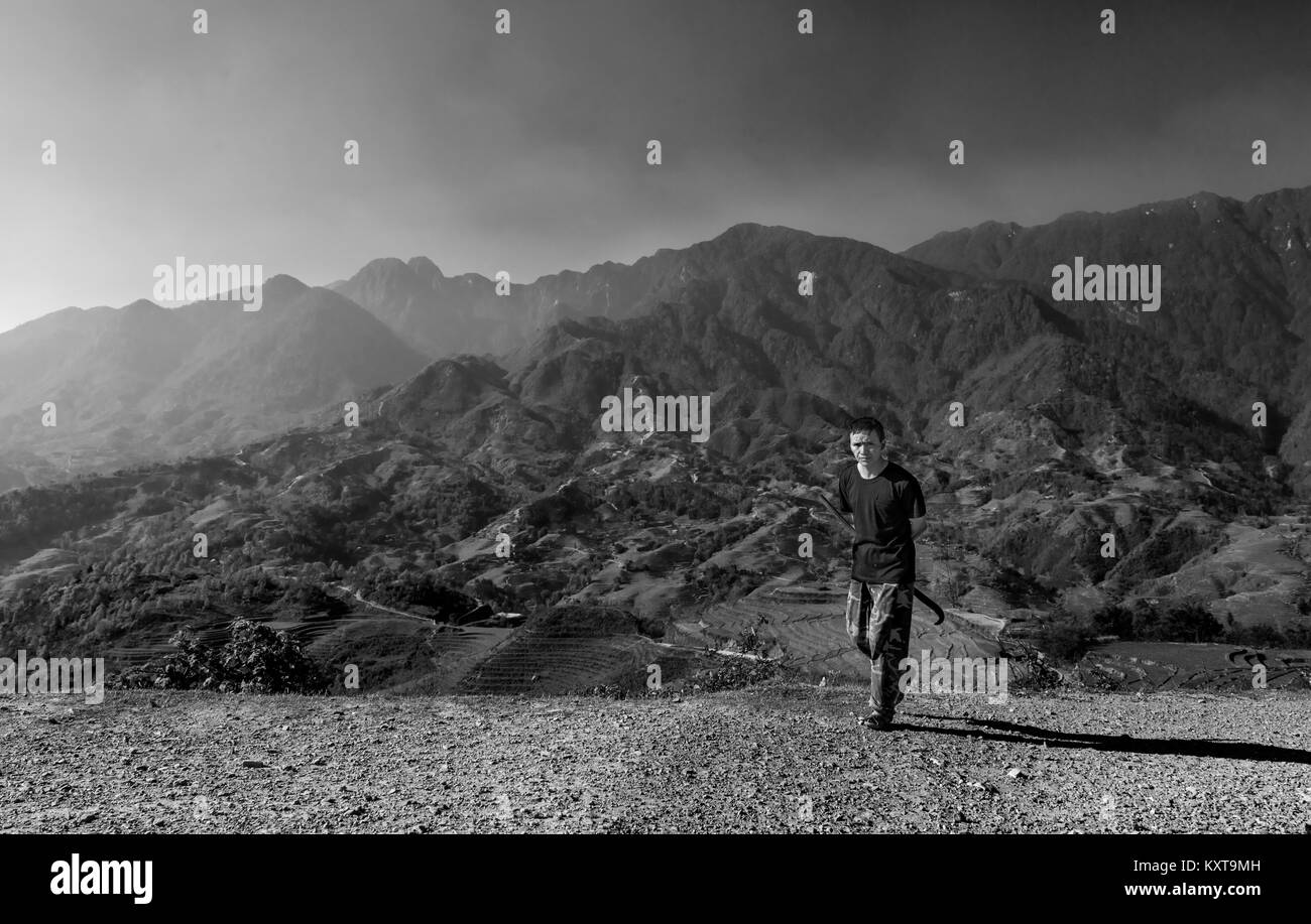 Farmer on the way to work in morning, Sapa, Vietnam - Stock Image