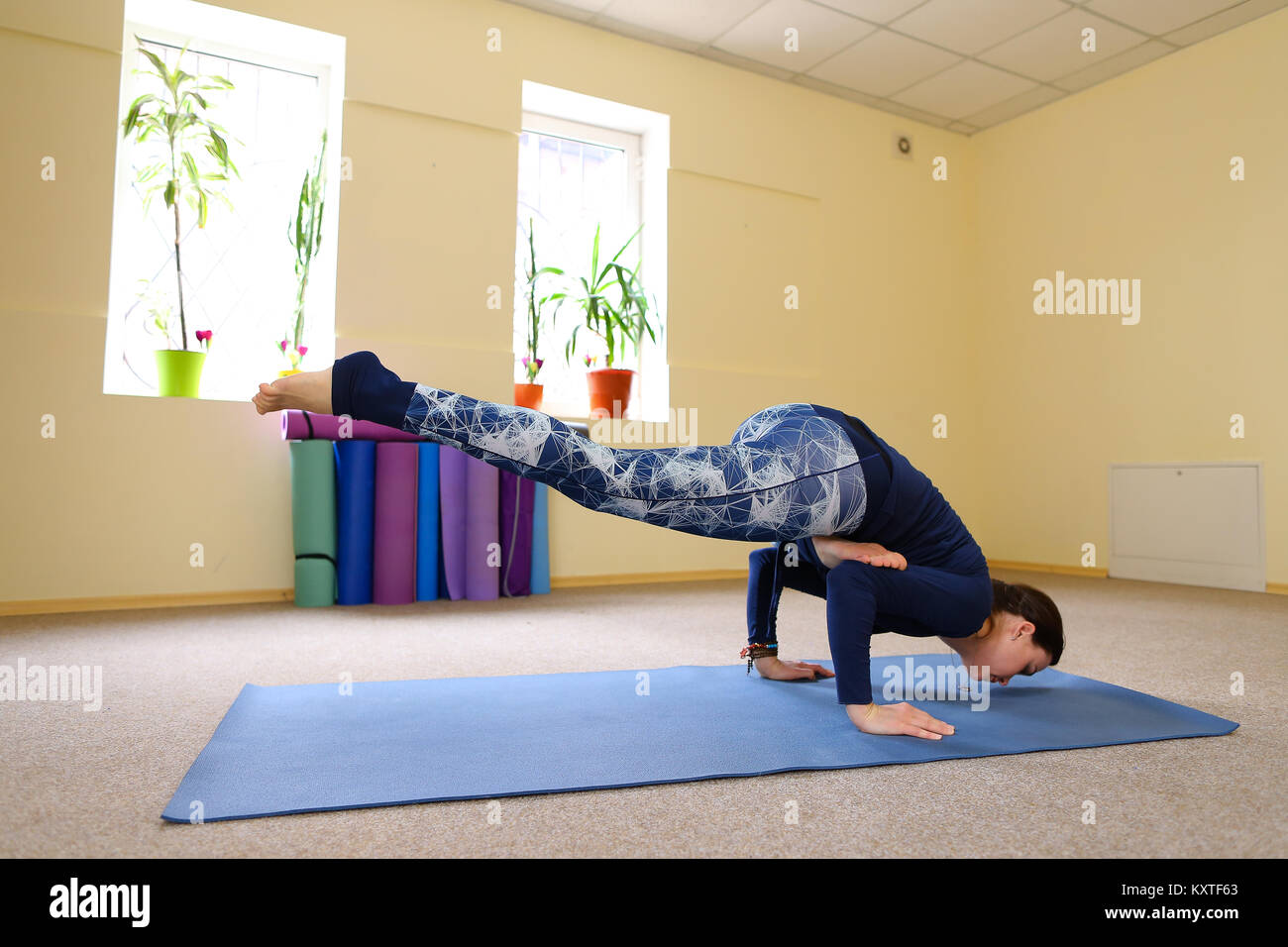 New mother use yoga class to relive pain in spine Stock