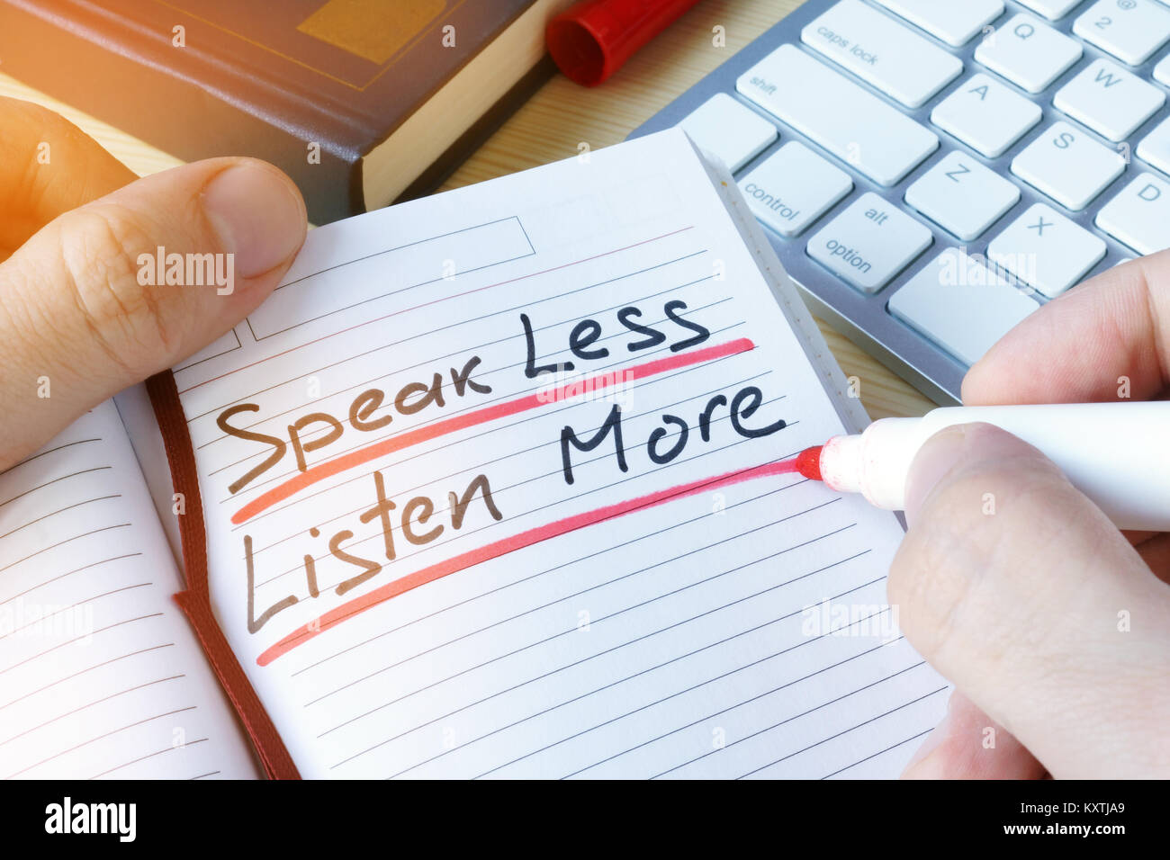 Man writing quote Speak less listen more. - Stock Image