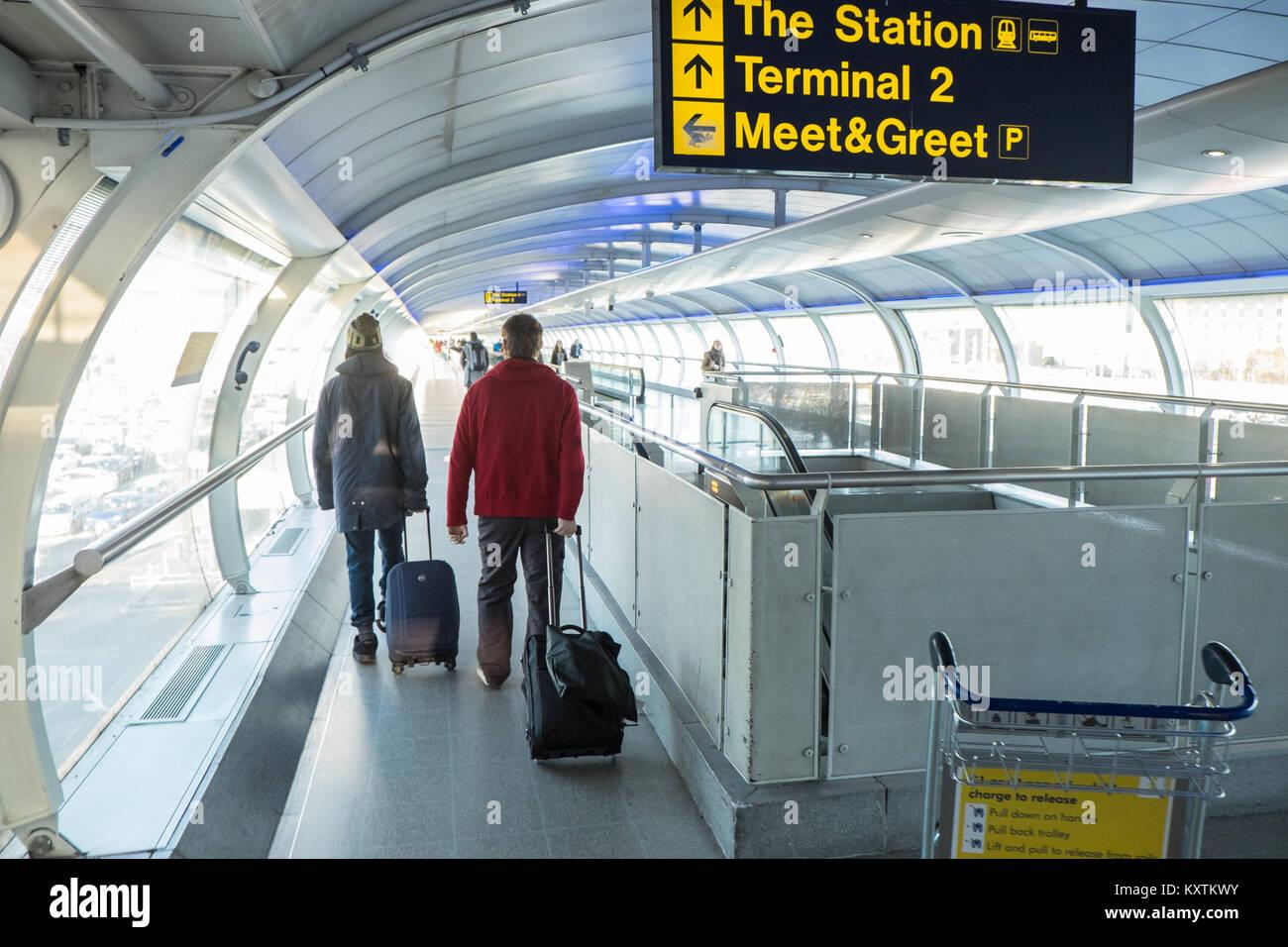 Walkway conveyor belt stock photos walkway conveyor belt stock passengerpassengerstravellingonconveyorbeltlinktransit m4hsunfo