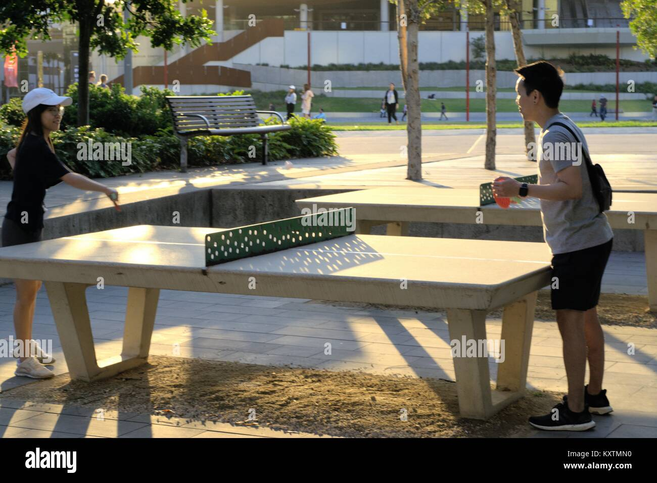 Sydney people playing table tennis at recreational area at Darling Harbour Sydney Australia. People in Sydney enjoying - Stock Image