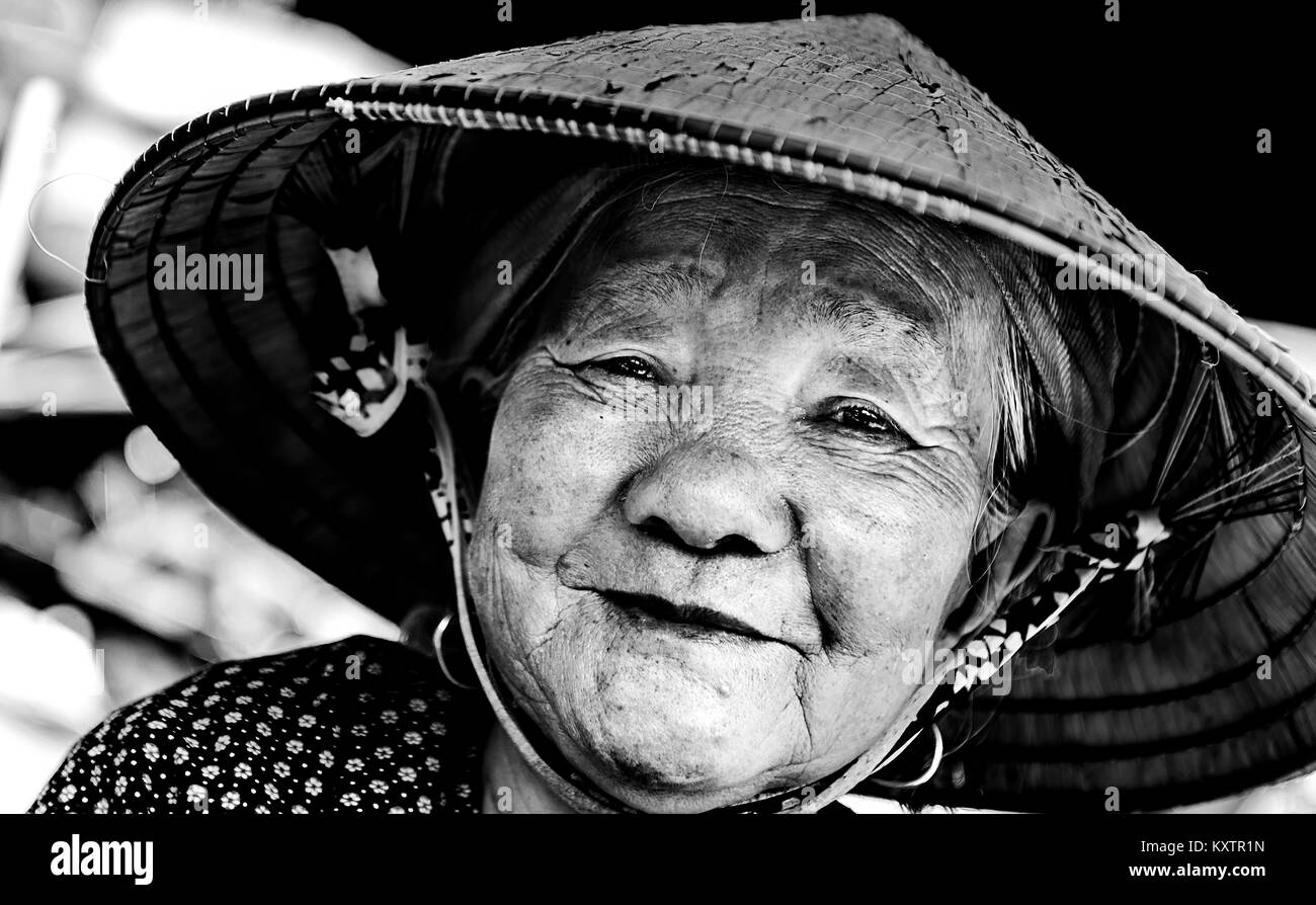 Portrait of old lady in a local market, Sapa, Vietnam - Stock Image