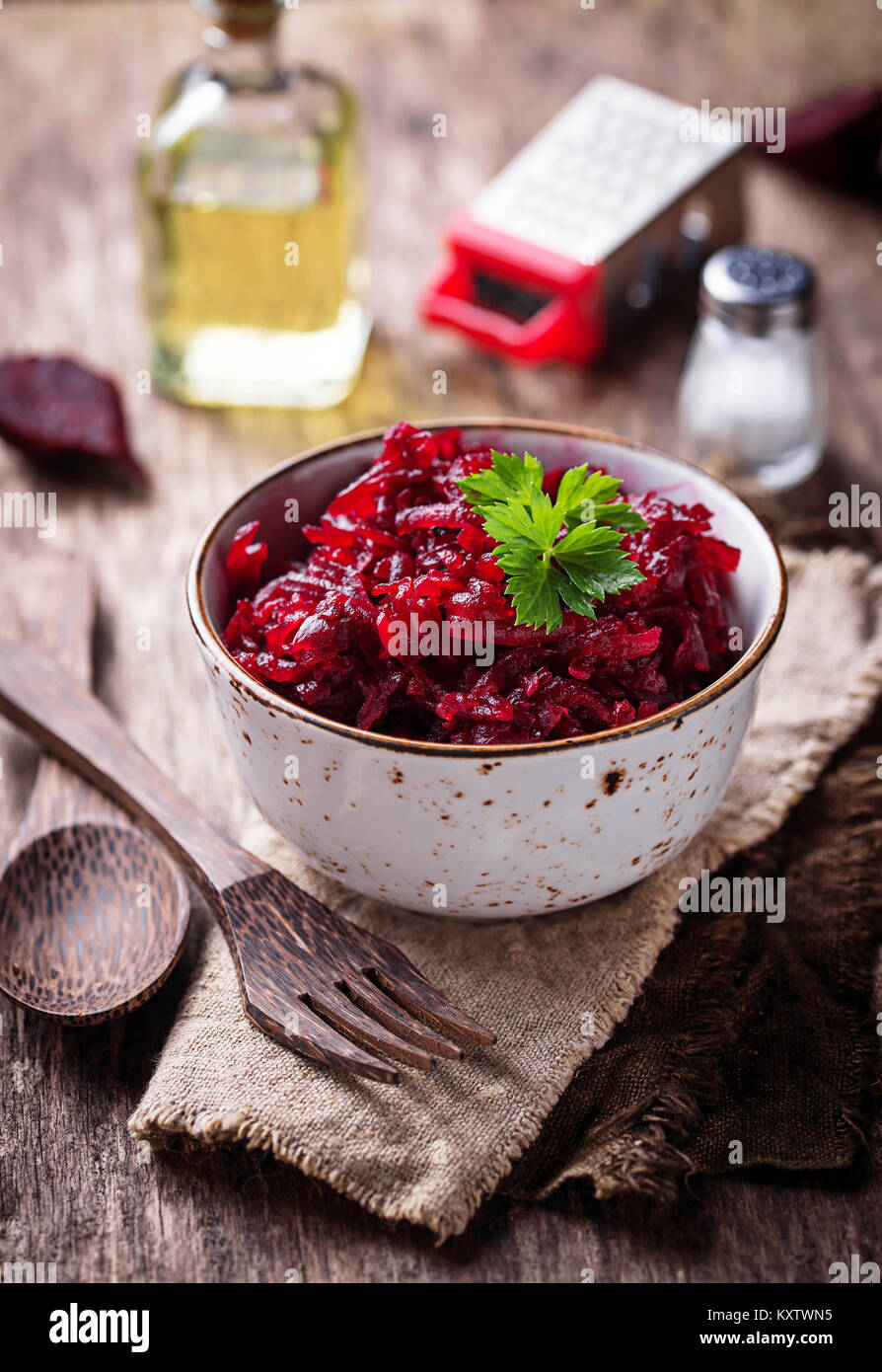 Bowl of beetroot salad on wooden background - Stock Image