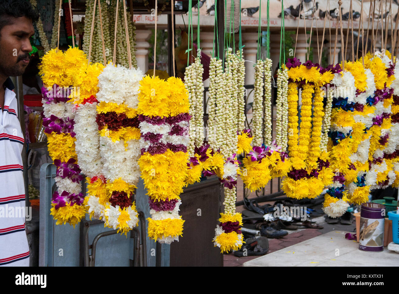 A vendor selling  flower garlands for the Hindu festival Diwali at Batu Caves, Selangor, Malaysia. Taken in November - Stock Image