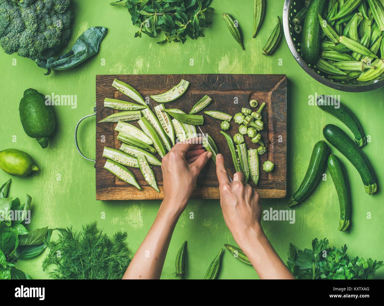 Flat-lay of healthy green vegan cooking ingredients - Stock Image