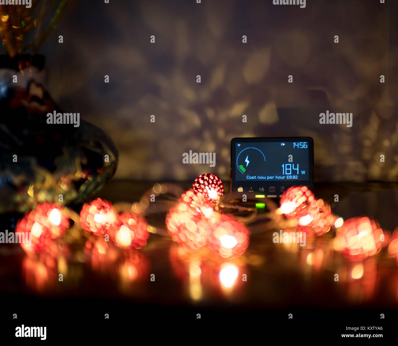 Christmas lights with smart meter measuring the output and cost to the householder. - Stock Image