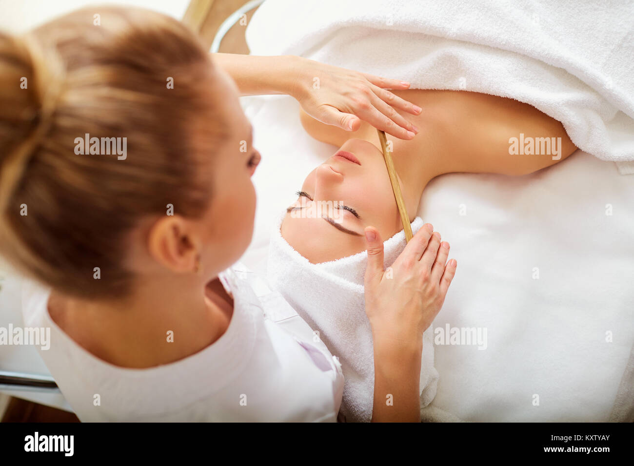 Massage face woman stone therapy. - Stock Image