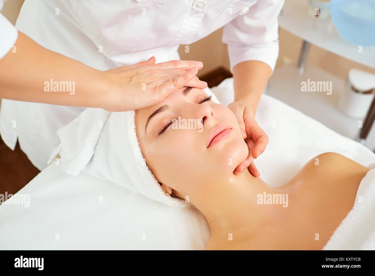 Beautiful woman at a facial massage. - Stock Image