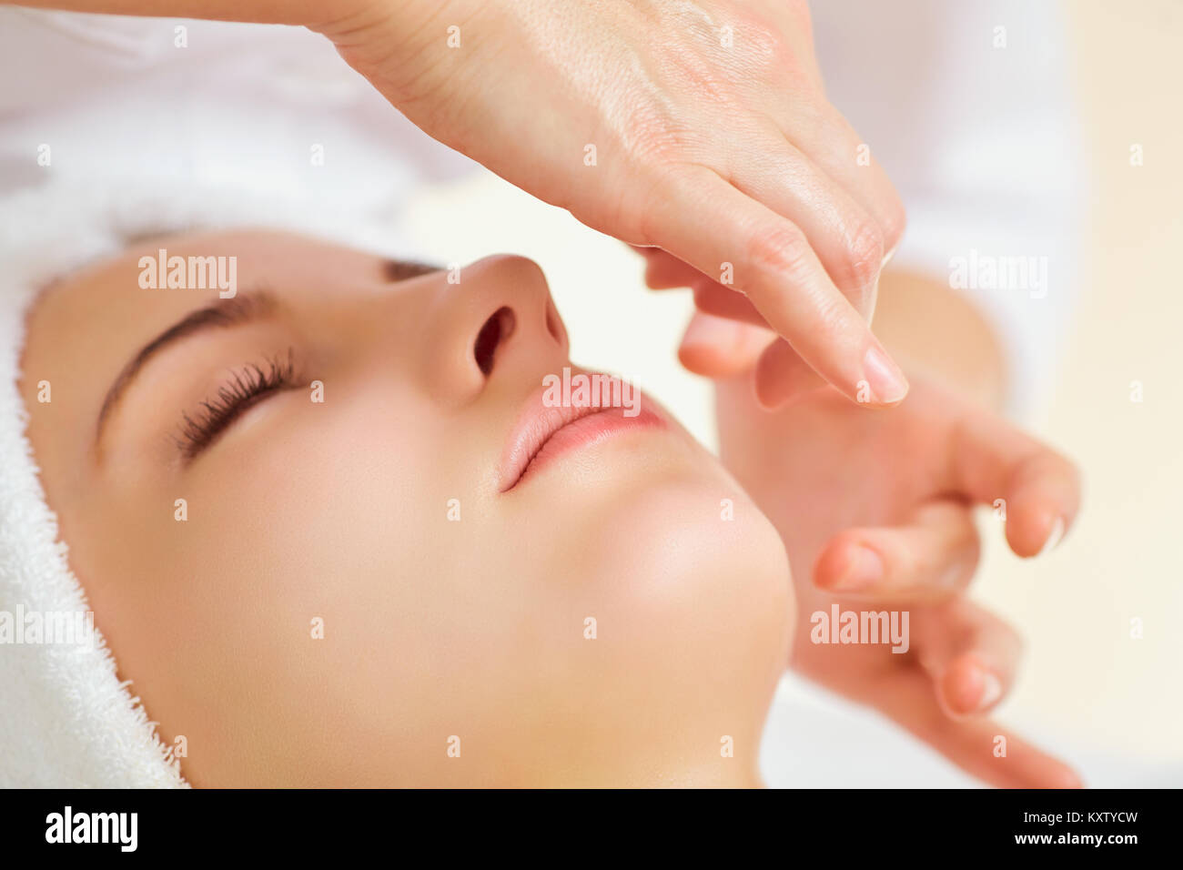 Beautiful woman at a facial massage. - Stock Image
