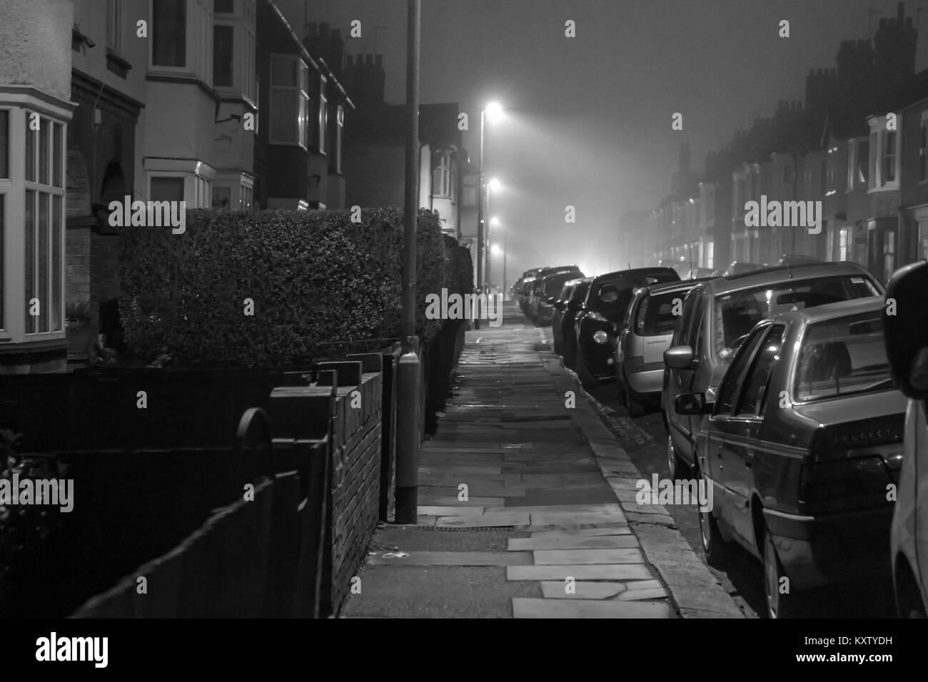 Street scene early evening in winter, Abington area, Northampton, U.K. - Stock Image