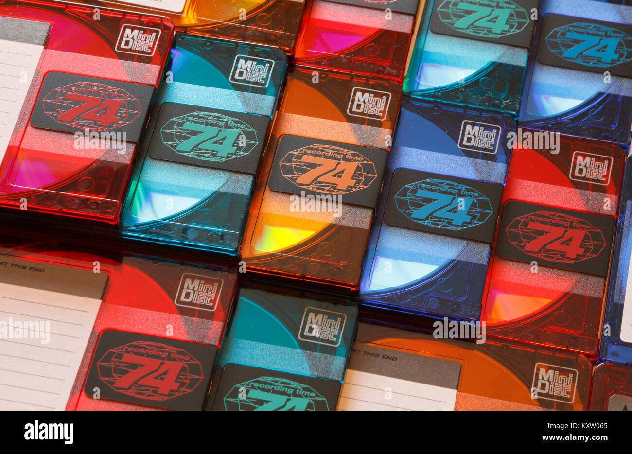 A few rows of blank colorful audio minidiscs media cartridges with a recording time of 74 minutes each. - Stock Image