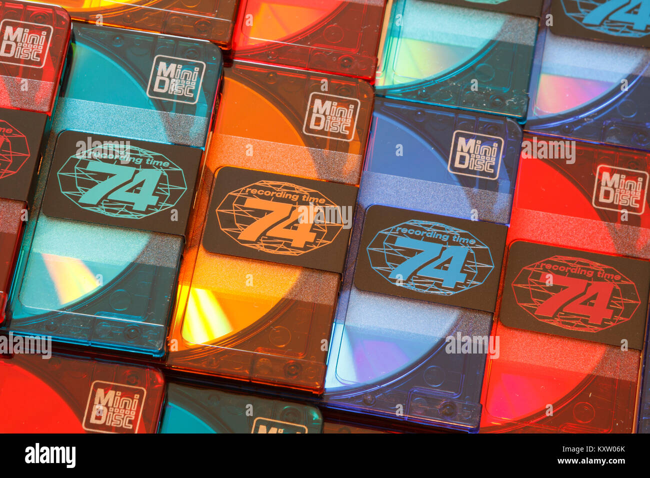 Close up view of a few rows of blank colorful audio minidiscs cartridges with a recording time of 74 minutes. - Stock Image