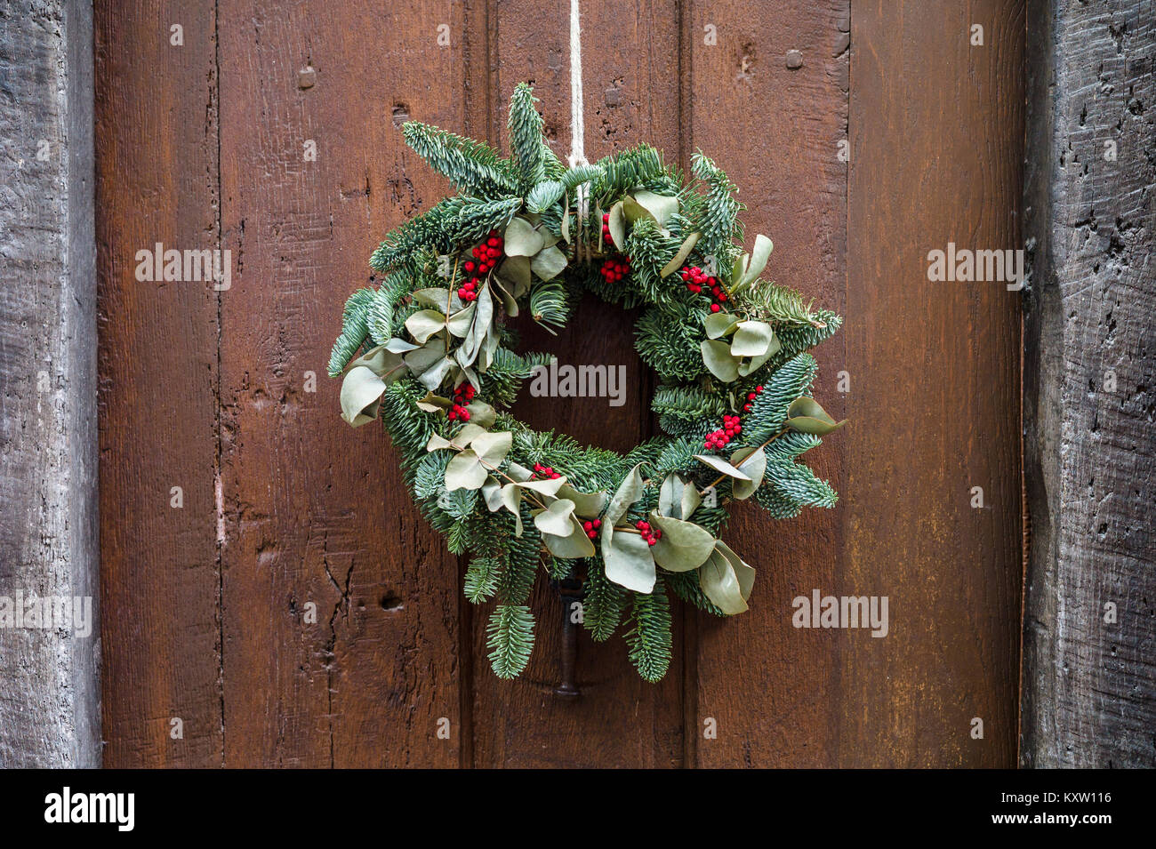 Front View Of A Traditional Christmas Crown Made Evergreen Branches Holly Leaves And Berries