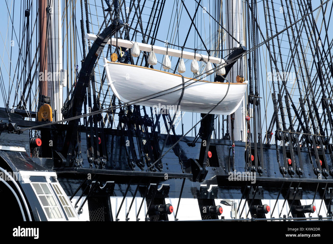 Whaleboat aka Lifeboat on the quarterdavits of the historic USS Constitution in Charlestown, Boston Massachusetts - Stock Image