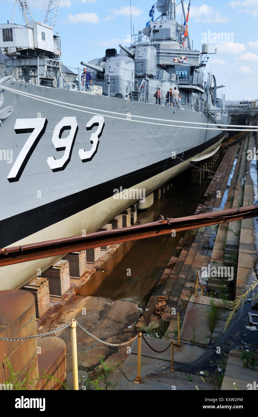 WW II destroyer USS Cassin Young in dry dock at the Charlestown Navy Yard, home of the USS Constitution Museum - Stock Image