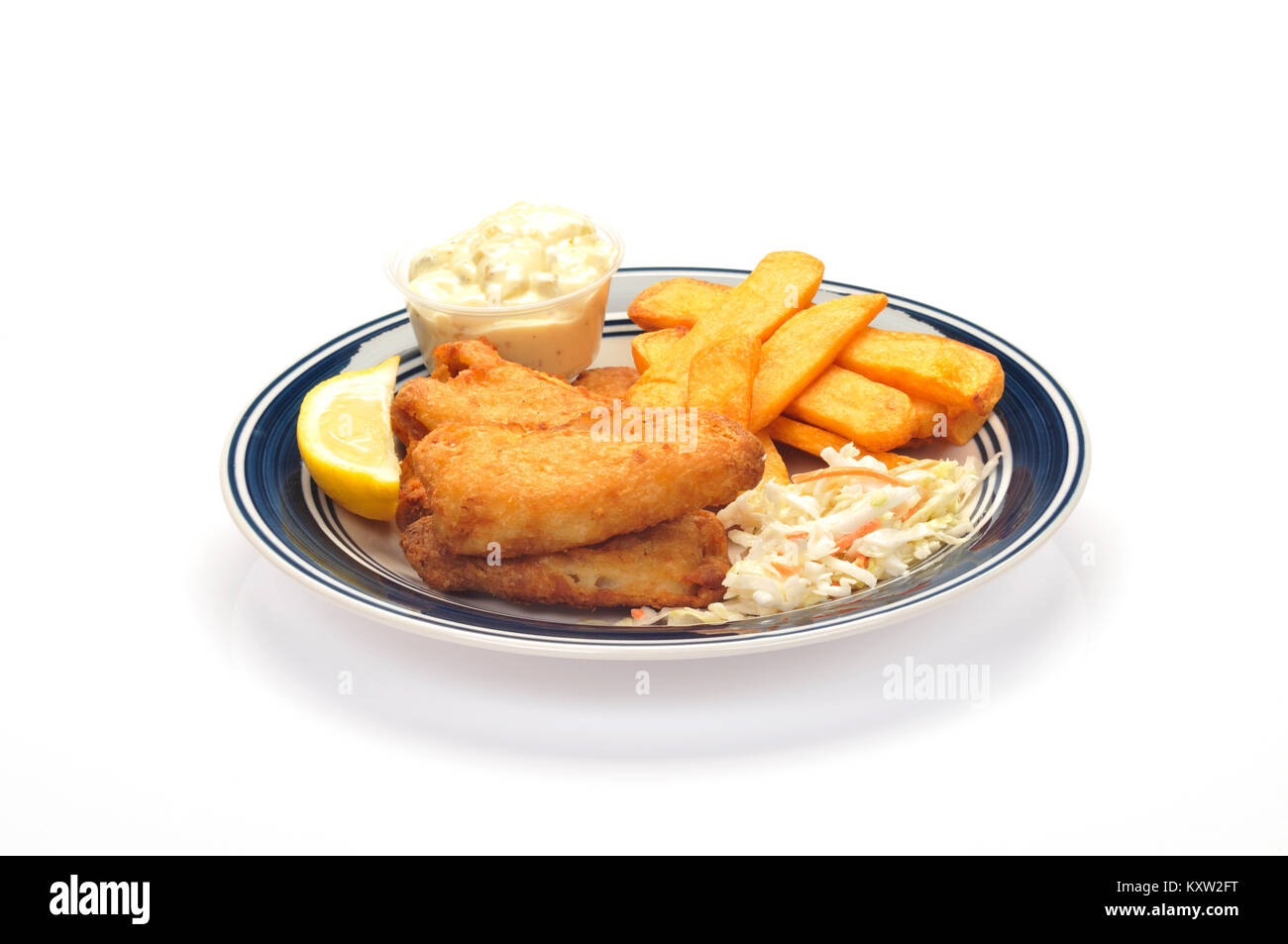 Fried fish and chips with coleslaw a wedge of lemon and tartar sauce on blue and white plate on white background - Stock Image