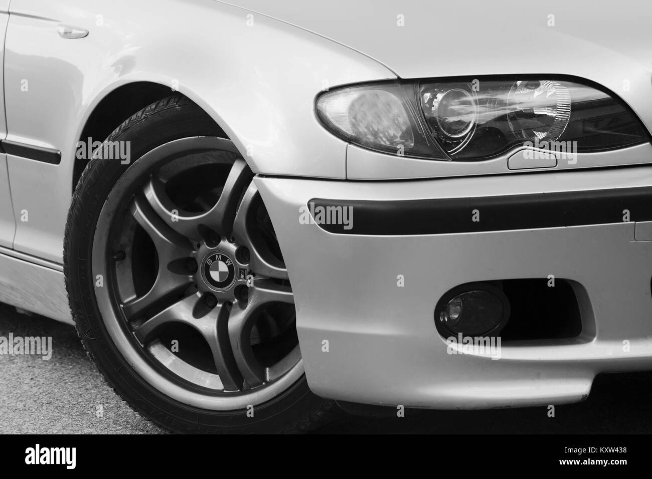 SOFIA, BULGARIA - APRIL 18, 2017: Black and white detail from BMW M3 in the country road. The BMW 3 Series is a - Stock Image