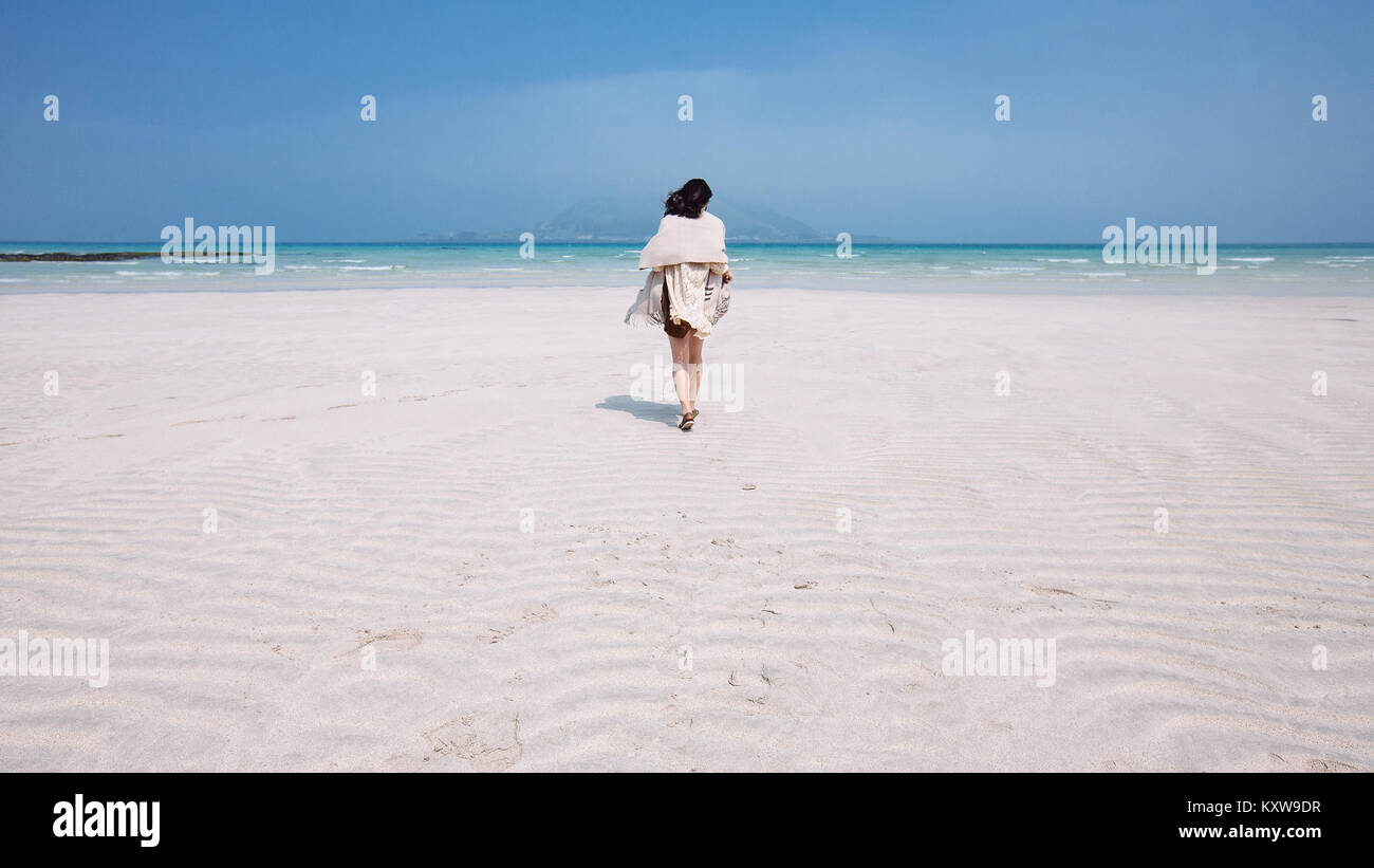 Walking in Tropical Getaway - Stock Image