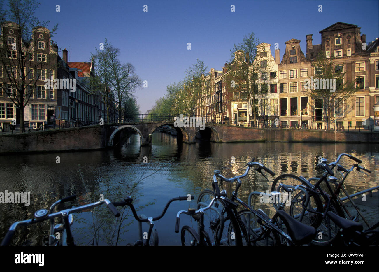 The Netherlands, Amsterdam, Canal called Herengracht.17th century. Bicycles. - Stock Image