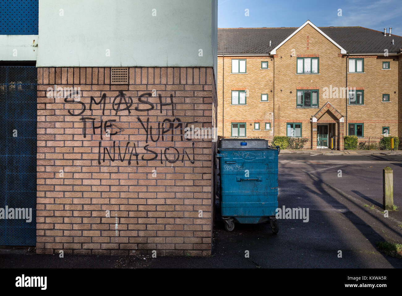Anti-redevelopment graffiti seen in Deptford, south east London as on-going property developing takes place near - Stock Image