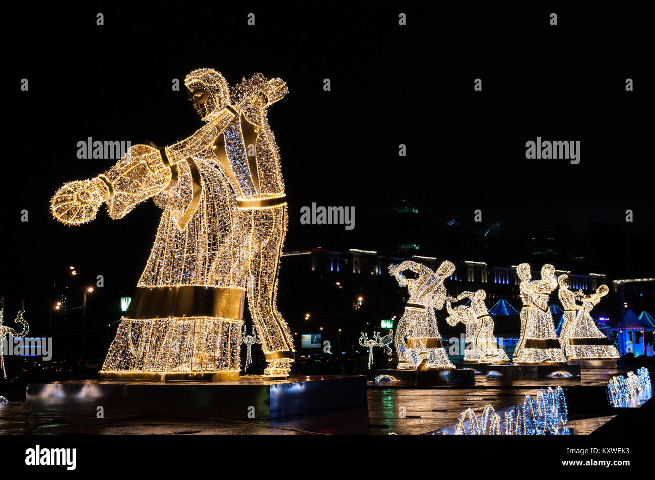 Giant figures of dancers erected for the Festival Trip to Christmas 2017-2018, Moscow, Russia - Stock Image