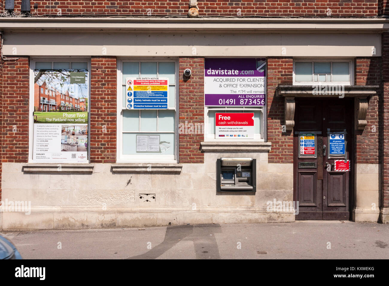 Closed down bank in small Berkshire town with notices of housing development. Goring, Berkshire, GB, UK - Stock Image